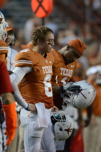 Nov 16, 2013; Austin, TX, USA; Texas Longhorns quarterback Case McCoy (6) reacts against the Oklahoma State Cowboys during the fourth quarter at Darrell K Royal-Texas Memorial Stadium. Oklahoma State beat Texas 38-13. Mandatory Credit: Brendan Maloney-USA TODAY Sports