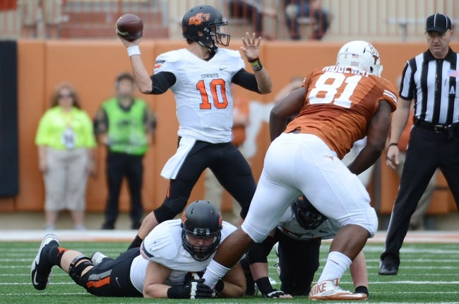 Nov 16, 2013; Austin, TX, USA; Oklahoma State Cowboys quarterback Clint Chelf (10) throws the ball against the Texas Longhorns during the first quarter at Darrell K Royal-Texas Memorial Stadium. Oklahoma State won 38-13. Mandatory Credit: Brendan Maloney-USA TODAY Sports