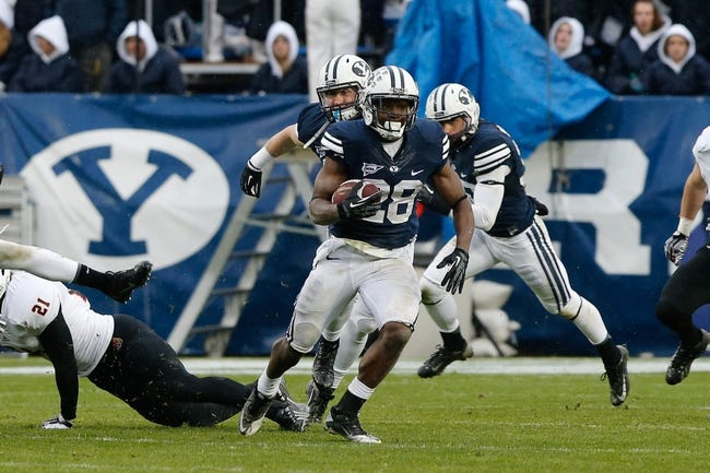 Nov 16, 2013; Provo, UT, USA; Brigham Young Cougars running back Adam Hine (28) runs the ball up the field against the Idaho State Bengals during the third quarter at Lavell Edwards Stadium. BYU won 59-13. Mandatory Credit: Chris Nicoll-USA TODAY Sports.
