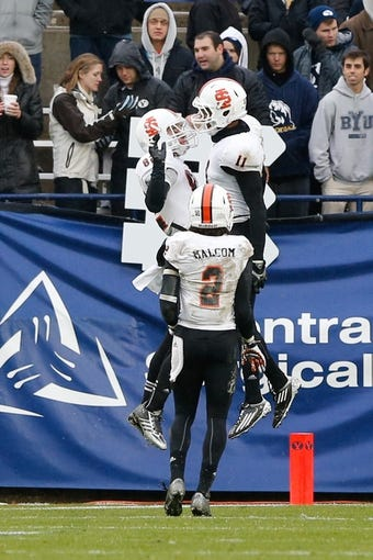 Nov 16, 2013; Provo, UT, USA; Idaho State Bengals wide receiver Luke Austin (82), tight end Josh Cook (11) and wide receiver Broc Malcom (2) celebrate in the end zone after a touchdown at Lavell Edwards Stadium. BYU won 59-13. Mandatory Credit: Chris Nicoll-USA TODAY Sports.