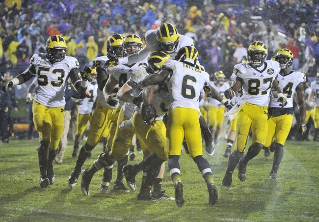 Nov 16, 2013; Evanston, IL, USA; The Michigan Wolverines celebrate their overtime win against the Northwestern Wildcats at Ryan Field. The Michigan Wolverines defeated the Northwestern Wildcats 27-19 in triple overtime. Mandatory Credit: David Banks-USA TODAY Sports