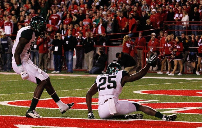 Nov 16, 2013; Lincoln, NE, USA; Michigan State Spartans receiver Keith Mumphery (25) holds the ball after scoring a touchdown with receiver Tony Lippett (14) against the Nebraska Cornhuskers in the fourth quarter at Memorial Stadium. Michigan State won 41-28. Mandatory Credit: Bruce Thorson-USA TODAY Sports