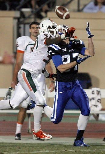 Nov 16, 2013; Durham, NC, USA; Duke Blue Devils wide receiver Max McCaffrey (87) pulls in a pass as Miami Hurricanes defensive back Ladarius Gunter (37) defends at Wallace Wade Stadium. Mandatory Credit: Mark Dolejs-USA TODAY Sports