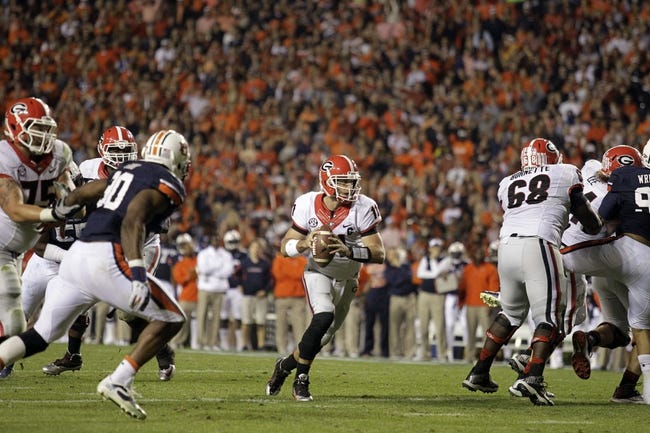 Nov 16, 2013; Auburn, AL, USA; Georgia Bulldogs quarterback Aaron Murray (11) carries the ball against the Auburn Tigers during the fourth quarter at Jordan Hare Stadium.  The Tigers beat the Bulldogs 43-38.  Mandatory Credit: John Reed-USA TODAY Sports