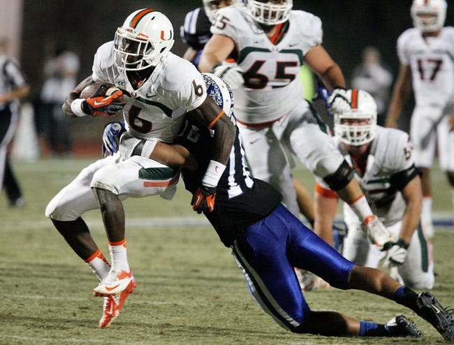 Nov 16, 2013; Durham, NC, USA; Duke Blue Devils safety Jeremy Cash (16) tackles Miami Hurricanes wide receiver Herb Waters (6) at Wallace Wade Stadium. Mandatory Credit: Mark Dolejs-USA TODAY Sports