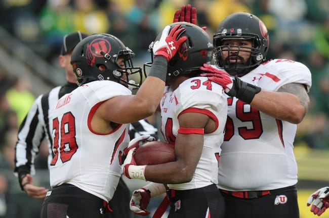 Nov 16, 2013; Eugene, OR, USA; Utah Utes running back Karl Williams (38) and Utes offensive linesman Junior Salt (59) celebrate with Utes running back Bubba Poole (34) against the Oregon Ducks at Autzen Stadium. Mandatory Credit: Scott Olmos-USA TODAY Sports