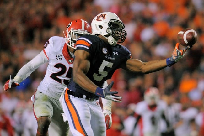 Nov 16, 2013; Auburn, AL, USA; Auburn Tigers wide receiver Ricardo Louis (5) catches a tipped ball by Georgia Bulldogs defensive back Josh Harvey-Clemons (25) and scores the game winning touchdown at Jordan Hare Stadium. The Tigers defeated the Bulldogs 43-38. Mandatory Credit: Shanna Lockwood-USA TODAY Sports