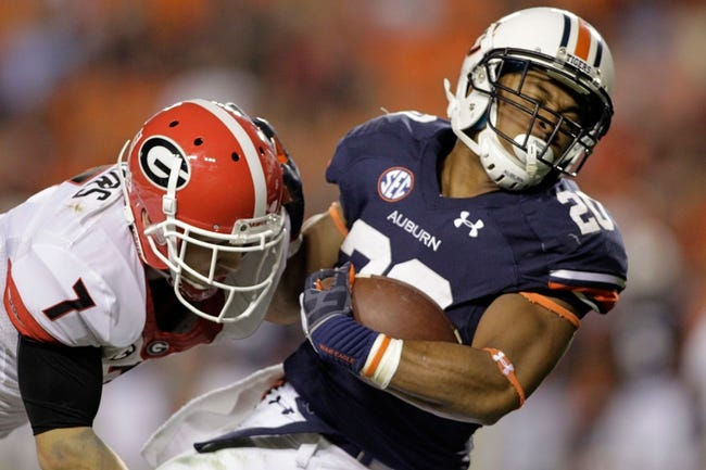 Nov 16, 2013; Auburn, AL, USA; Georgia Bulldogs cornerback Blake Sailors (7) tackles Auburn Tigers running back Corey Grant (20) during the fourth quarter at Jordan Hare Stadium.  The Tigers beat the Bulldogs 43-38.  Mandatory Credit: John Reed-USA TODAY Sports