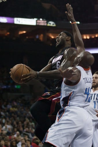 Nov 16, 2013; Charlotte, NC, USA; Miami Heat small forward LeBron James (6) goes up for a shot while Charlotte Bobcats power forward Anthony Tolliver (43) defends during the first half at Time Warner Cable Arena. Mandatory Credit: Jeremy Brevard-USA TODAY Sports