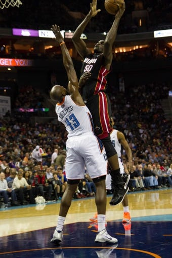 Nov 16, 2013; Charlotte, NC, USA; Miami Heat center Joel Anthony (50) shoots the ball over Charlotte Bobcats power forward Anthony Tolliver (43) during the first half at Time Warner Cable Arena. Mandatory Credit: Jeremy Brevard-USA TODAY Sports