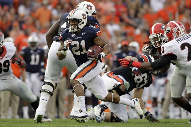 Nov 16, 2013; Auburn, AL, USA; Auburn Tigers running back Tre Mason (21) runs with the ball against the Georgia Bulldogs during the first half at Jordan Hare Stadium. The Tigers won 43-38. Mandatory Credit: John Reed-USA TODAY Sports