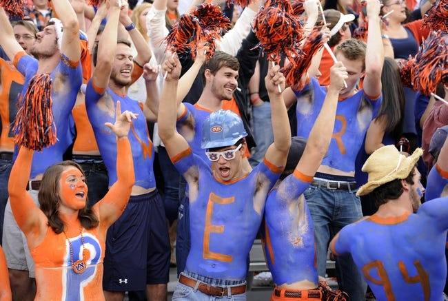 Nov 16, 2013; Auburn, AL, USA; Auburn Tigers fans cheer prior to the game against the Georgia Bulldogs at Jordan Hare Stadium. The Tigers defeated the Bulldogs 43-38. Mandatory Credit: Shanna Lockwood-USA TODAY Sports