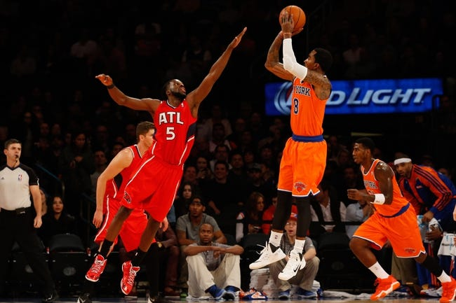 Nov 16, 2013; New York, NY, USA;  New York Knicks shooting guard J.R. Smith (8) shoots over Atlanta Hawks small forward DeMarre Carroll (5) during the first quarter at Madison Square Garden. Mandatory Credit: Anthony Gruppuso-USA TODAY Sports