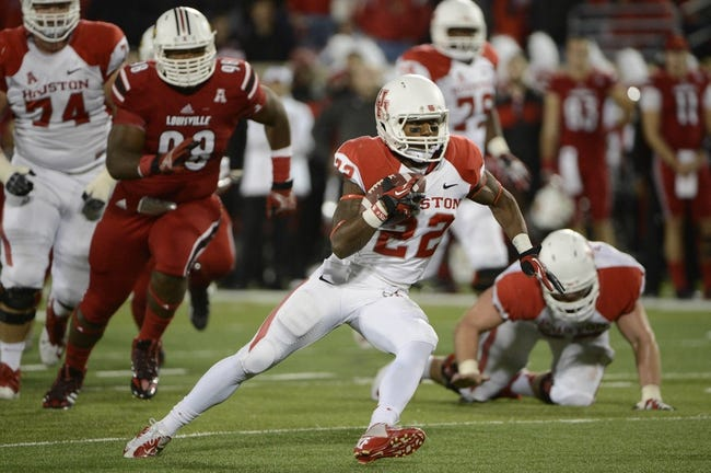 Nov 16, 2013; Louisville, KY, USA; Houston Cougars running back Ryan Jackson (22) runs with the ball against the Louisville Cardinals during the second quarter at Papa John's Cardinal Stadium. Mandatory Credit: Jamie Rhodes-USA TODAY Sports