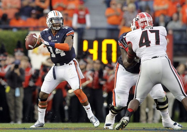 Nov 16, 2013; Auburn, AL, USA; Auburn Tigers quarterback Nick Marshall (14) drops back to pass against the Georgia Bulldogs during the first half at Jordan Hare Stadium.  The Tigers beat the Bulldogs 43-38.  Mandatory Credit: John Reed-USA TODAY Sports