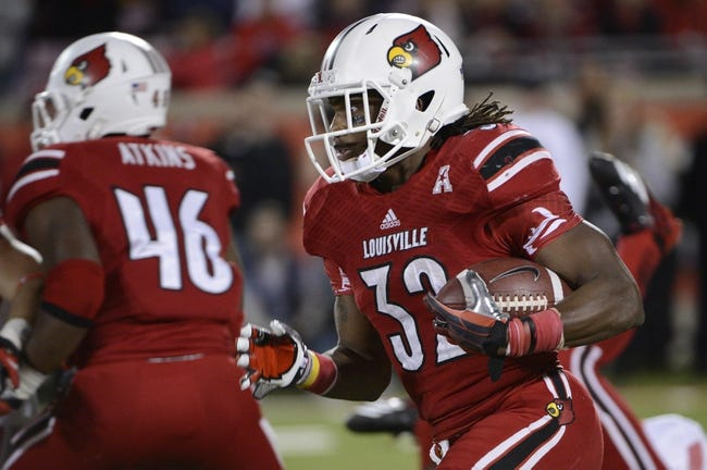 Nov 16, 2013; Louisville, KY, USA; Louisville Cardinals running back Senorise Perry (32) runs with the ball against the Houston Cougars during the second quarter at Papa John's Cardinal Stadium. Mandatory Credit: Jamie Rhodes-USA TODAY Sports