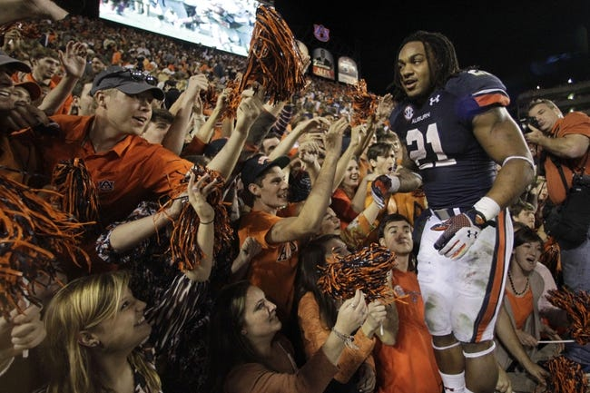 Nov 16, 2013; Auburn, AL, USA; Auburn Tigers running back Tre Mason (21) celebrates with fans after beating the Georgia Bulldogs 43-38 at Jordan Hare Stadium.  Mandatory Credit: John Reed-USA TODAY Sports