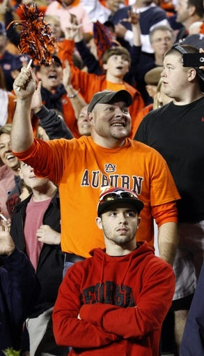 Nov 16, 2013; Auburn, AL, USA; Auburn Tigers fans celebrate a touchdown against the Georgia Bulldogs in the fourth quarter at Jordan Hare Stadium. The Tigers won 43-38.  Mandatory Credit: John Reed-USA TODAY Sports