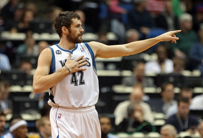 Nov 16, 2013; Minneapolis, MN, USA; Minnesota Timberwolves power forward Kevin Love (42) points to a teammate in the first half against the Boston Celtics at Target Center. Mandatory Credit: Jesse Johnson-USA TODAY Sports