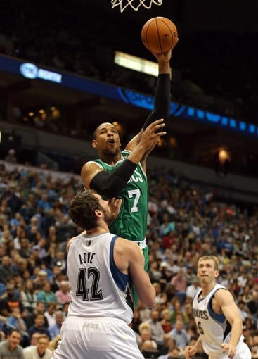 Nov 16, 2013; Minneapolis, MN, USA; Boston Celtics power forward Jared Sullinger (7) goes up for a shot over Minnesota Timberwolves power forward Kevin Love (42) in the first half at Target Center. Mandatory Credit: Jesse Johnson-USA TODAY Sports