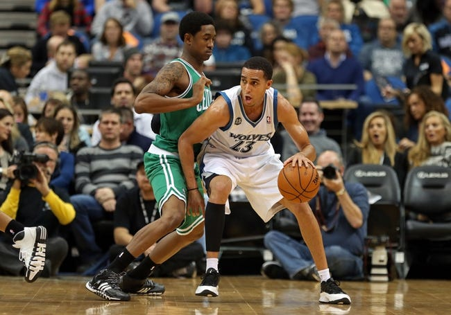 Nov 16, 2013; Minneapolis, MN, USA; Minnesota Timberwolves shooting guard Kevin Martin (23) attempts to get to the basket past Boston Celtics shooting guard MarShon Brooks (12) in the first half at Target Center. Mandatory Credit: Jesse Johnson-USA TODAY Sports