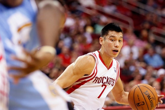 Nov 16, 2013; Houston, TX, USA; Houston Rockets guard Jeremy Lin (7) drives to the basket against the Denver Nuggets during the first half at Toyota Center. Mandatory Credit: Soobum Im-USA TODAY Sports
