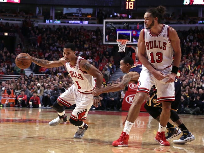 Nov 16, 2013; Chicago, IL, USA; Chicago Bulls point guard Derrick Rose (1) drives past Indiana Pacers point guard George Hill (3) with Chicago Bulls center Joakim Noah (13) setting a pick during the second quarter at  the United Center. Mandatory Credit: Dennis Wierzbicki-USA TODAY Sports