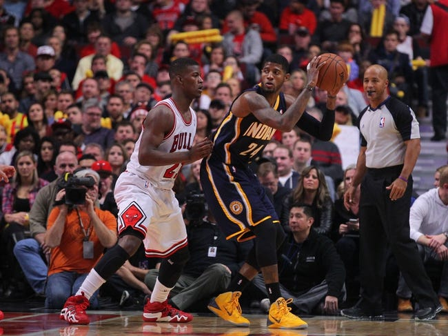 Nov 16, 2013; Chicago, IL, USA; Indiana Pacers small forward Paul George (24) is defended by Chicago Bulls shooting guard Jimmy Butler (21) during the second quarter at  the United Center. Mandatory Credit: Dennis Wierzbicki-USA TODAY Sports