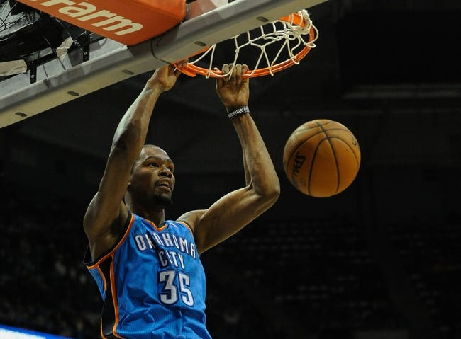 Nov 16, 2013; Milwaukee, WI, USA;  Oklahoma City Thunder forward Kevin Durant (35) dunks a basket during the game against the Milwaukee Bucks in the 2nd quarter at BMO Harris Bradley Center. Mandatory Credit: Benny Sieu-USA TODAY Sports