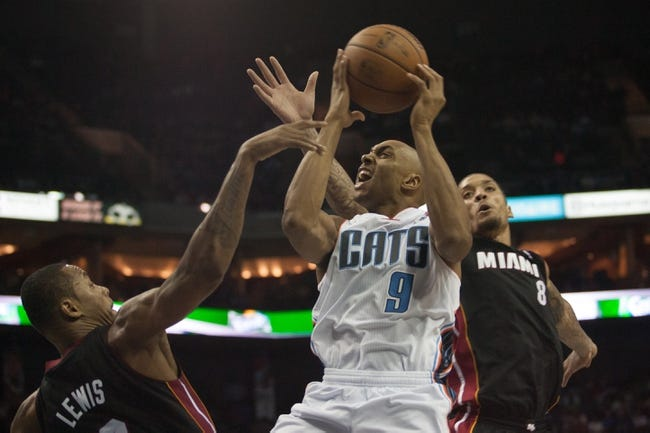 Nov 16, 2013; Charlotte, NC, USA; Charlotte Bobcats shooting guard Gerald Henderson (9) goes up for a shot over Miami Heat power forward Rashard Lewis (9) during the second half at Time Warner Cable Arena. Miami defeated Charlotte 97-81. Mandatory Credit: Jeremy Brevard-USA TODAY Sports