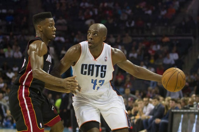 Nov 16, 2013; Charlotte, NC, USA; Charlotte Bobcats power forward Anthony Tolliver (43) looks to pass the ball while Miami Heat point guard Norris Cole (30) defends during the second half at Time Warner Cable Arena. Miami defeated Charlotte 97-81. Mandatory Credit: Jeremy Brevard-USA TODAY Sports