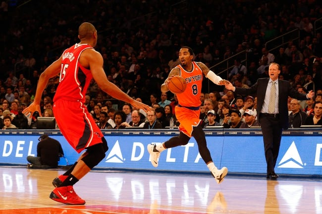 Nov 16, 2013; New York, NY, USA;  New York Knicks shooting guard J.R. Smith (8) prepares to drive around Atlanta Hawks center Al Horford (15) during the third quarter at Madison Square Garden. Atlanta Hawks won 110-90.  Mandatory Credit: Anthony Gruppuso-USA TODAY Sports