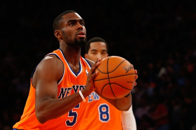 Nov 16, 2013; New York, NY, USA;  New York Knicks shooting guard Tim Hardaway Jr. (5) shoots a free throw during the fourth quarter against the Atlanta Hawks at Madison Square Garden. Atlanta Hawks won 110-90.  Mandatory Credit: Anthony Gruppuso-USA TODAY Sports