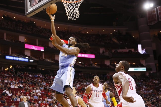 Nov 16, 2013; Houston, TX, USA; Denver Nuggets forward Kenneth Faried (35) shoots the ball as Houston Rockets center Dwight Howard (12) and forward Terrence Jones (6) look on during the second half at Toyota Center. The Rockets won 122-111. Mandatory Credit: Soobum Im-USA TODAY Sports