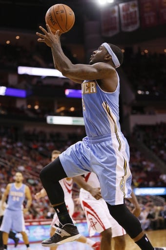 Nov 16, 2013; Houston, TX, USA; Denver Nuggets guard Ty Lawson (3) shoots the ball during the second half against the Houston Rockets at Toyota Center. The Rockets won 122-111. Mandatory Credit: Soobum Im-USA TODAY Sports