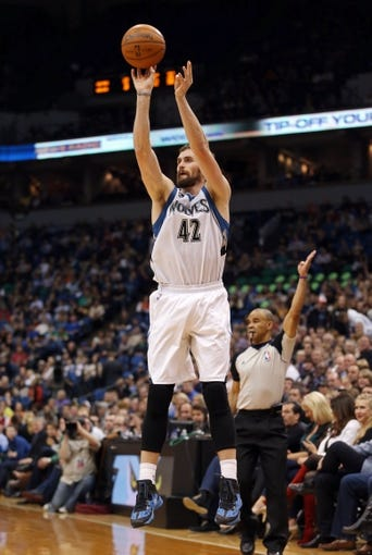 Nov 16, 2013; Minneapolis, MN, USA; Minnesota Timberwolves power forward Kevin Love (42) goes up for a shot in the second half against the Boston Celtics at Target Center. The Timberwolves won 106-88. Mandatory Credit: Jesse Johnson-USA TODAY Sports