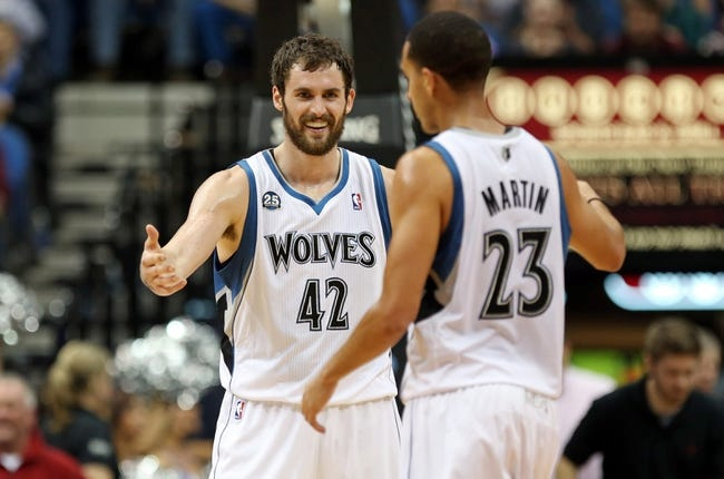 Nov 16, 2013; Minneapolis, MN, USA; Minnesota Timberwolves power forward Kevin Love (42) smiles and congratulates Minnesota Timberwolves shooting guard Kevin Martin (23) after making a three point shot in the second half against the Boston Celtics at Target Center. The TImberwolves won 106-88. Mandatory Credit: Jesse Johnson-USA TODAY Sports