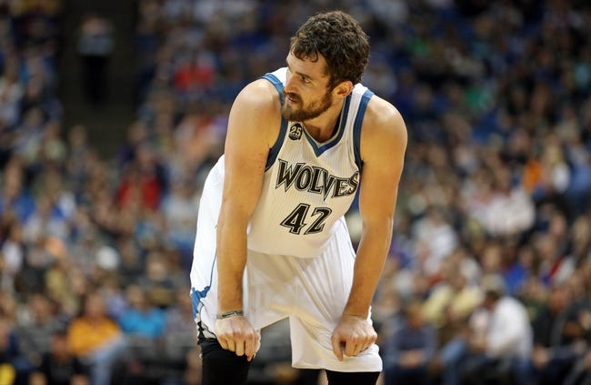 Nov 16, 2013; Minneapolis, MN, USA; Minnesota Timberwolves power forward Kevin Love (42) looks on in the second half against the Boston Celtics at Target Center. The Timberwolves won 106-88. Mandatory Credit: Jesse Johnson-USA TODAY Sports