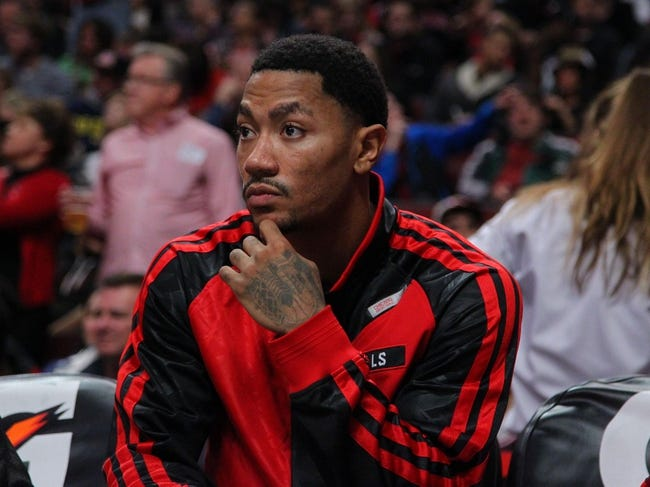 Nov 16, 2013; Chicago, IL, USA; Chicago Bulls point guard Derrick Rose (1) on the bench during the second half against the Indiana Pacers at  the United Center. Chicago won 110-94. Mandatory Credit: Dennis Wierzbicki-USA TODAY Sports