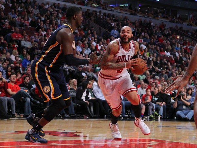 Nov 16, 2013; Chicago, IL, USA; Chicago Bulls power forward Carlos Boozer (5) drives against Indiana Pacers center Roy Hibbert (55)during the second half at  the United Center. Chicago won 110-94. Mandatory Credit: Dennis Wierzbicki-USA TODAY Sports