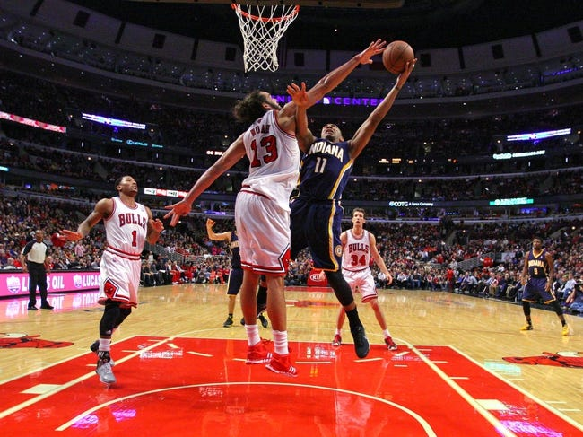 Nov 16, 2013; Chicago, IL, USA; Indiana Pacers shooting guard Orlando Johnson (11) shoots over Chicago Bulls center Joakim Noah (13) during the second half at  the United Center. Chicago won 110-94. Mandatory Credit: Dennis Wierzbicki-USA TODAY Sports
