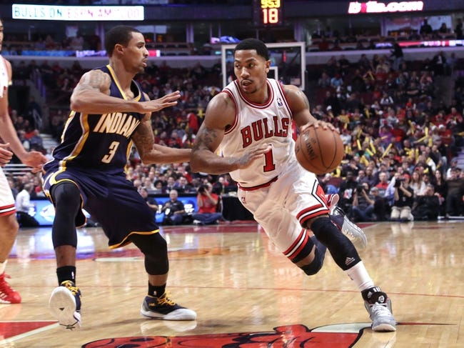 Nov 16, 2013; Chicago, IL, USA; Chicago Bulls point guard Derrick Rose (1) drives around Indiana Pacers point guard George Hill (3)during the second half at  the United Center. Chicago won 110-94. Mandatory Credit: Dennis Wierzbicki-USA TODAY Sports