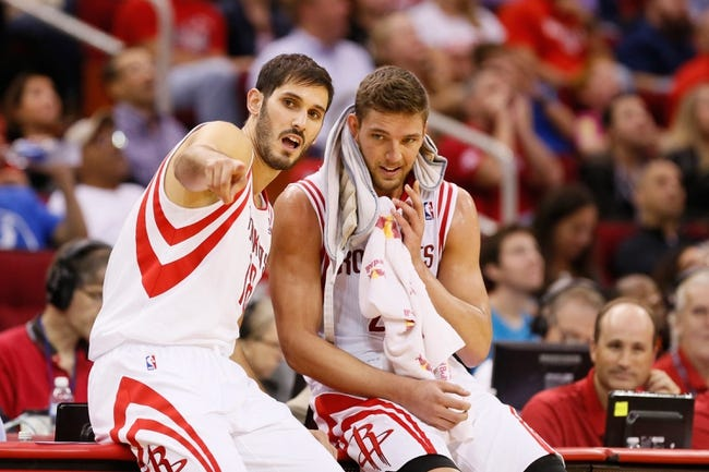 Nov 16, 2013; Houston, TX, USA; Houston Rockets forward Omri Casspi (18) talks with teammate Chandler Parsons (25) during the second half against the Denver Nuggets at Toyota Center. The Rockets won 122-111. Mandatory Credit: Soobum Im-USA TODAY Sports
