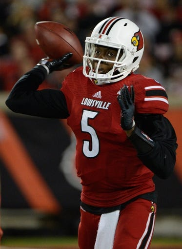 Nov 16, 2013; Louisville, KY, USA; Louisville Cardinals quarterback Teddy Bridgewater (5) looks to pass the ball against the Houston Cougars during the second half of play at Papa John's Cardinal Stadium. Louisville defeated Houston 20-13.  Mandatory Credit: Jamie Rhodes-USA TODAY Sports