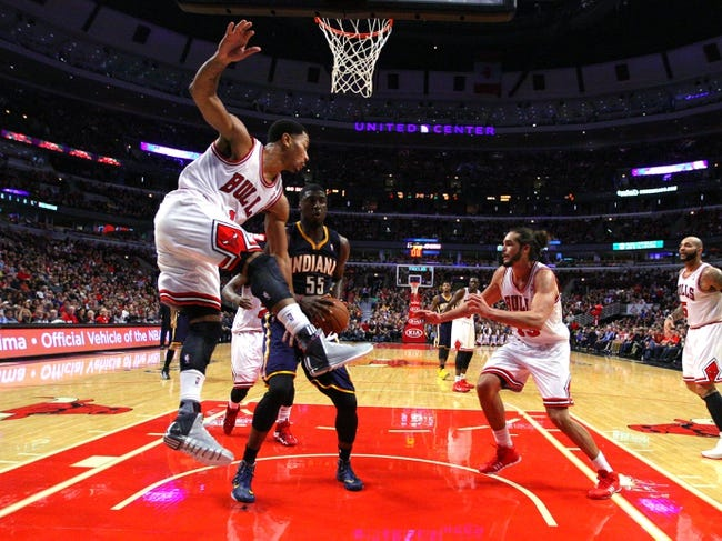 Nov 16, 2013; Chicago, IL, USA; Chicago Bulls point guard Derrick Rose (1) and Indiana Pacers center Roy Hibbert (55) fight for a rebound during the second half at  the United Center. Chicago won 110-94. Mandatory Credit: Dennis Wierzbicki-USA TODAY Sports