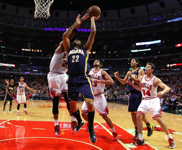 Nov 16, 2013; Chicago, IL, USA; Chicago Bulls power forward Taj Gibson (22) blocks the shot of Indiana Pacers small forward Chris Copeland (22) during the second half at  the United Center. Chicago won 110-94. Mandatory Credit: Dennis Wierzbicki-USA TODAY Sports