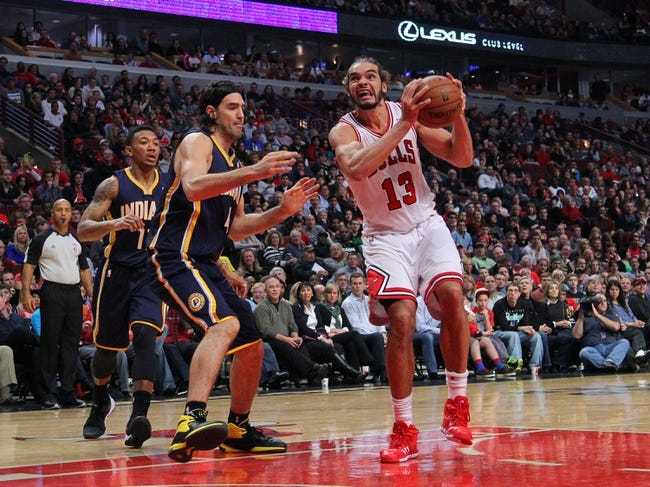 Nov 16, 2013; Chicago, IL, USA; Chicago Bulls center Joakim Noah (13) drives past Indiana Pacers power forward Luis Scola (4) during the second half at  the United Center. Chicago won 110-94. Mandatory Credit: Dennis Wierzbicki-USA TODAY Sports
