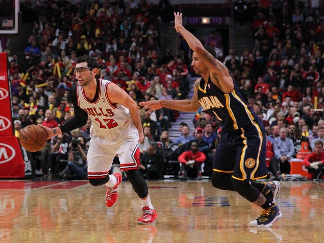 Nov 16, 2013; Chicago, IL, USA; Chicago Bulls shooting guard Kirk Hinrich (12) drives past Indiana Pacers point guard George Hill (3) during the second half at  the United Center. Chicago won 110-94. Mandatory Credit: Dennis Wierzbicki-USA TODAY Sports