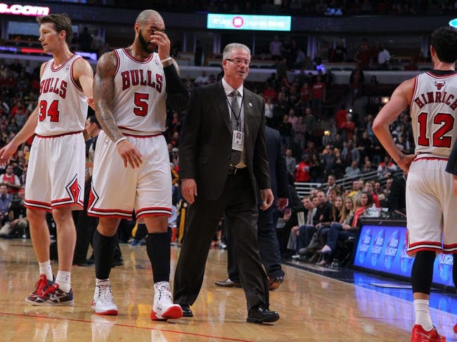 Nov 16, 2013; Chicago, IL, USA; Chicago Bulls power forward Carlos Boozer (5) is escorted off the court by security after being called for a double technical foul and being ejected during the second half against the Indiana Pacers at  the United Center. Chicago won 110-94. Mandatory Credit: Dennis Wierzbicki-USA TODAY Sports