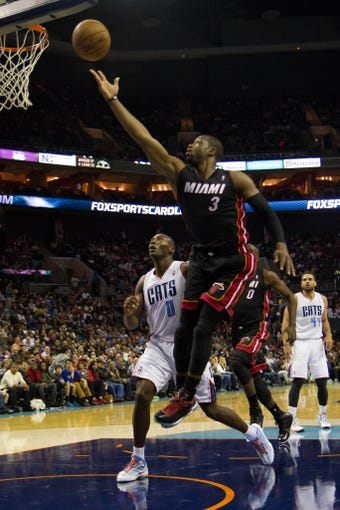 Nov 16, 2013; Charlotte, NC, USA; Miami Heat shooting guard Dwyane Wade (3) goes up for a shot against the Charlotte Bobcats during the first half at Time Warner Cable Arena. Mandatory Credit: Jeremy Brevard-USA TODAY Sports